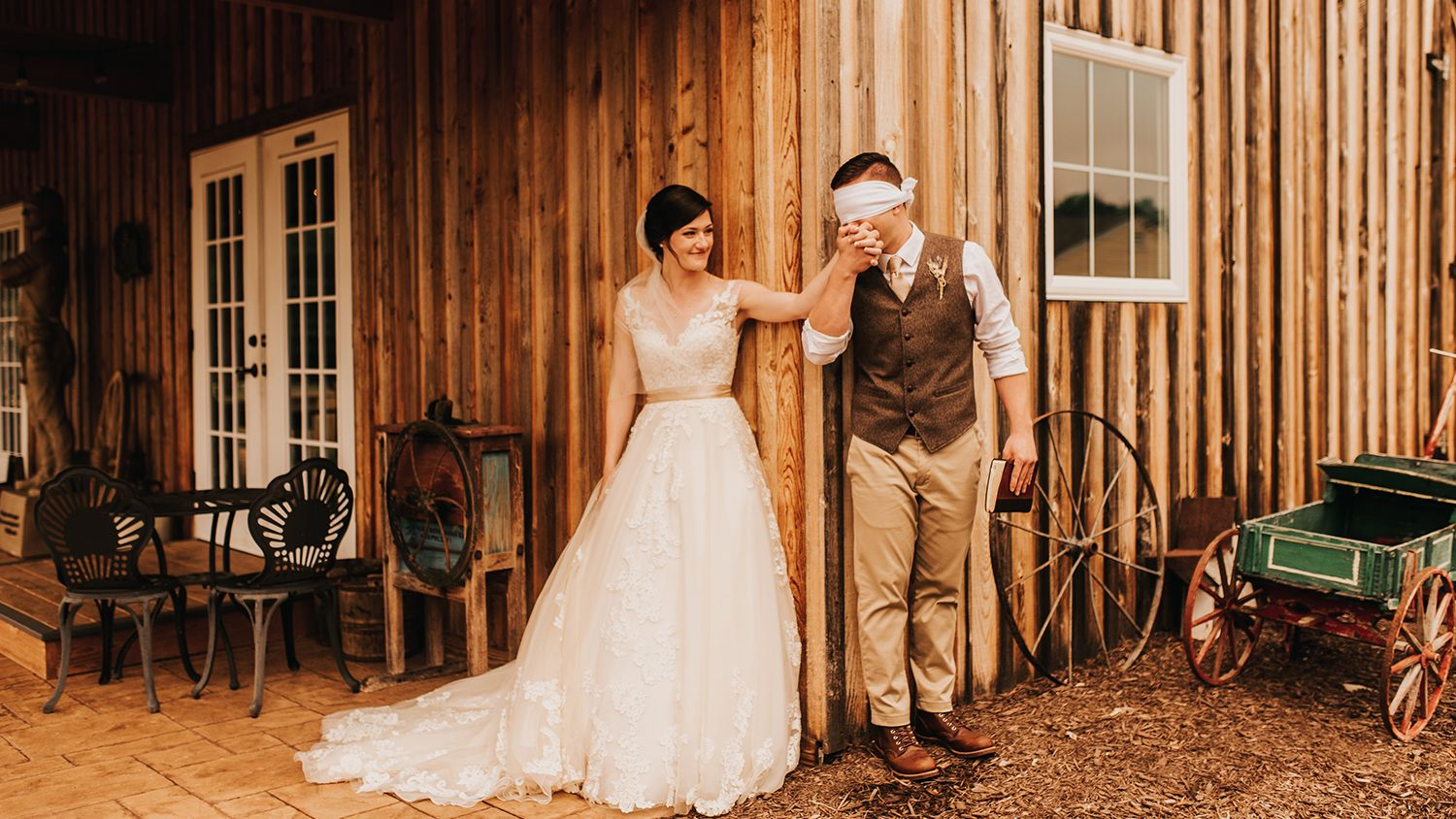 Bride And Groom Outside Reception Barn