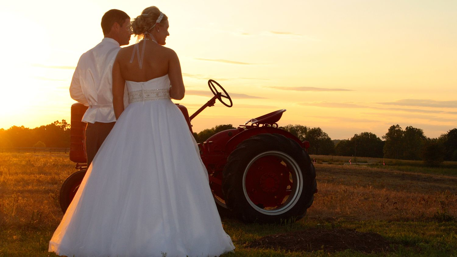 Bride And Groom Red Tractor With Sunset
