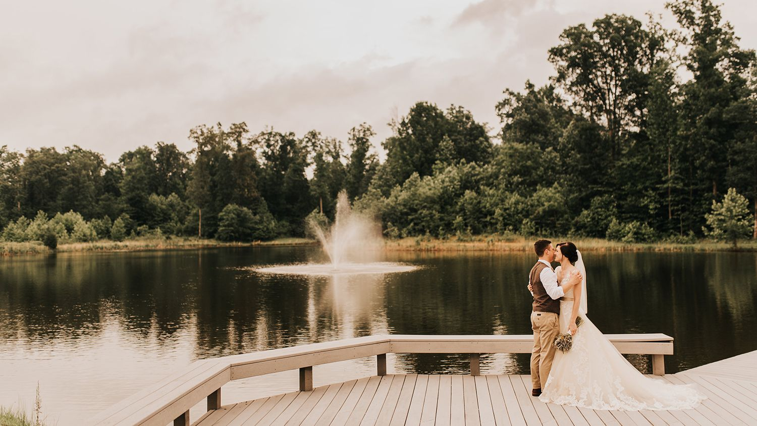 Bride And Groom At Pond With Fountain