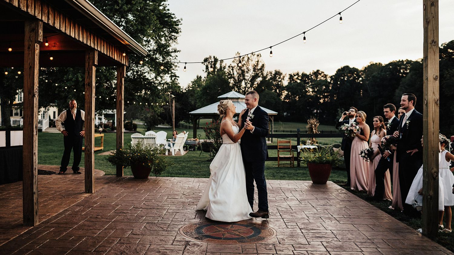 Bride And Groom Dancing on Patio of  Reception Barn