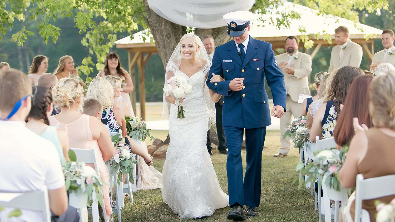 Bride And Groom with Ceremony in front of Maple Tree
