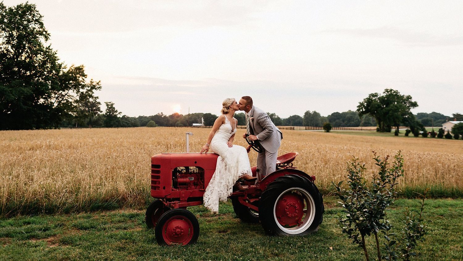 Bride And Groom Kissing On Tractor