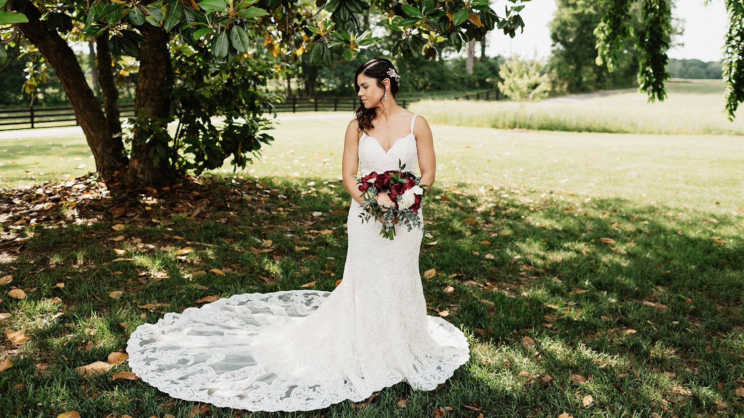 Bride Holding Flowers Under Magnolia Tree