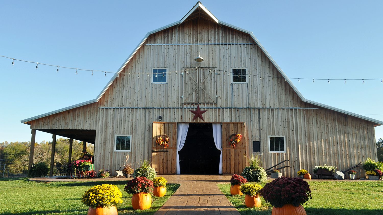 Reception Barn Path With Pumpkins and Mums Fall