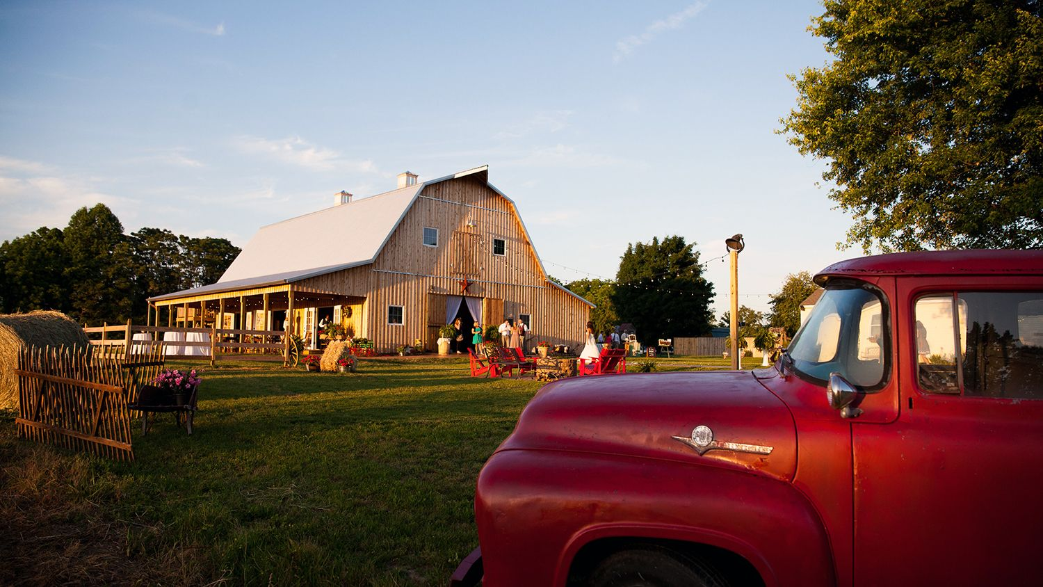 Red Pickup Truck And Reception Barn