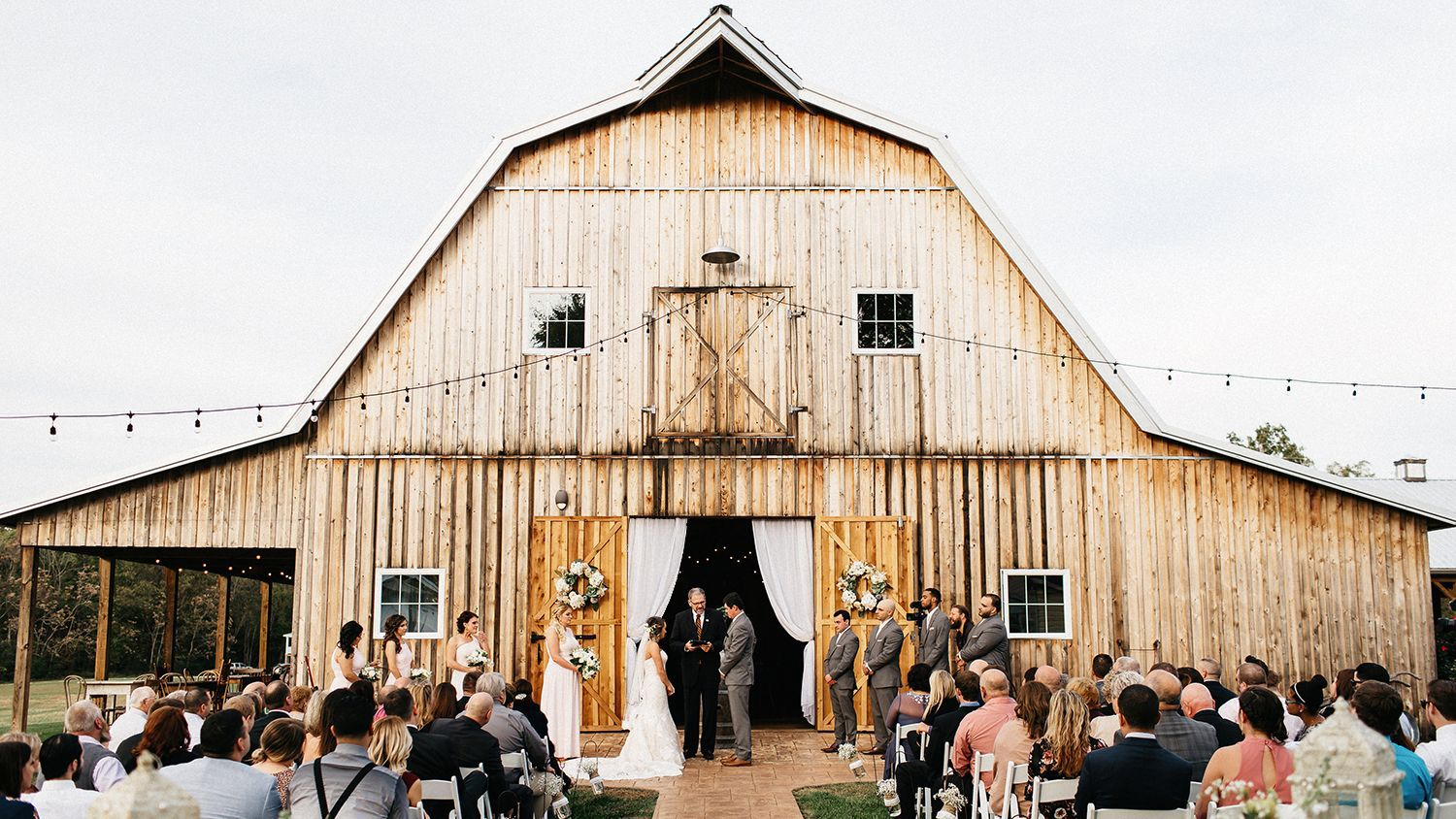 Wedding Ceremony in Front of Reception Barn