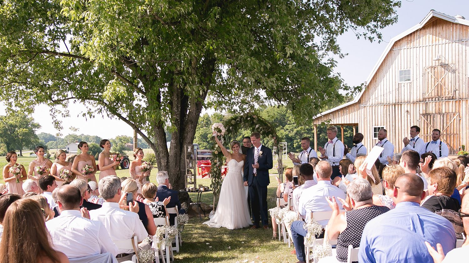 Wedding Ceremony under Oak tree close to Barn